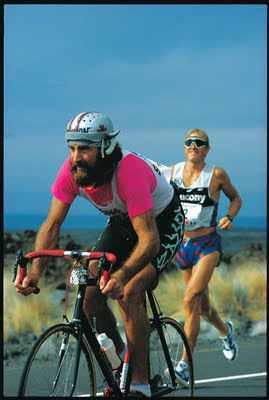 Cownman with Scott Tinley at the 1985 Hawaii Ironman(image via bbke.blogspot.com)